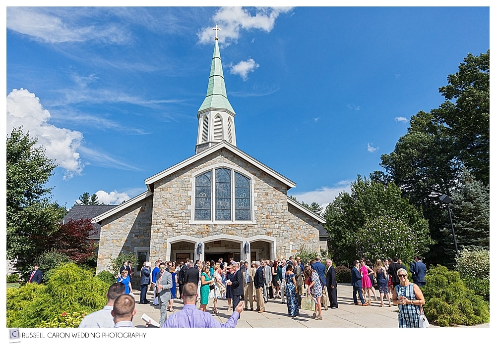 guests leaving St. Kathryn's Church after wedding ceremony