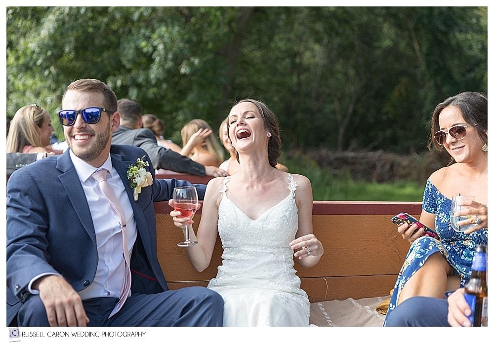bride laughing during hayride