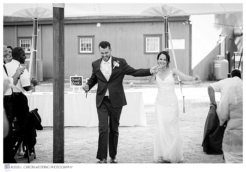 bride and groom arriving at their Parlee Farms wedding reception