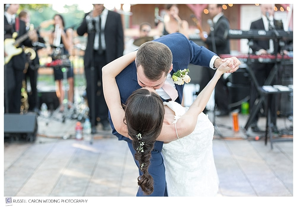 groom dipping and kissing the bride during their first dance