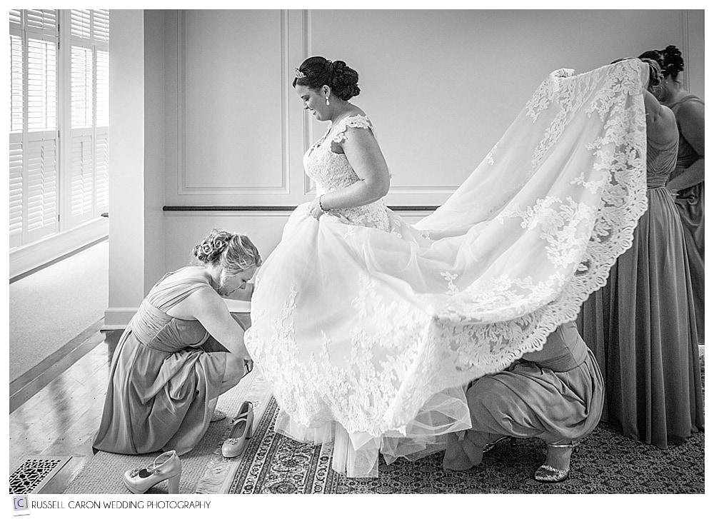 bridesmaids-helping-bride-into-dress