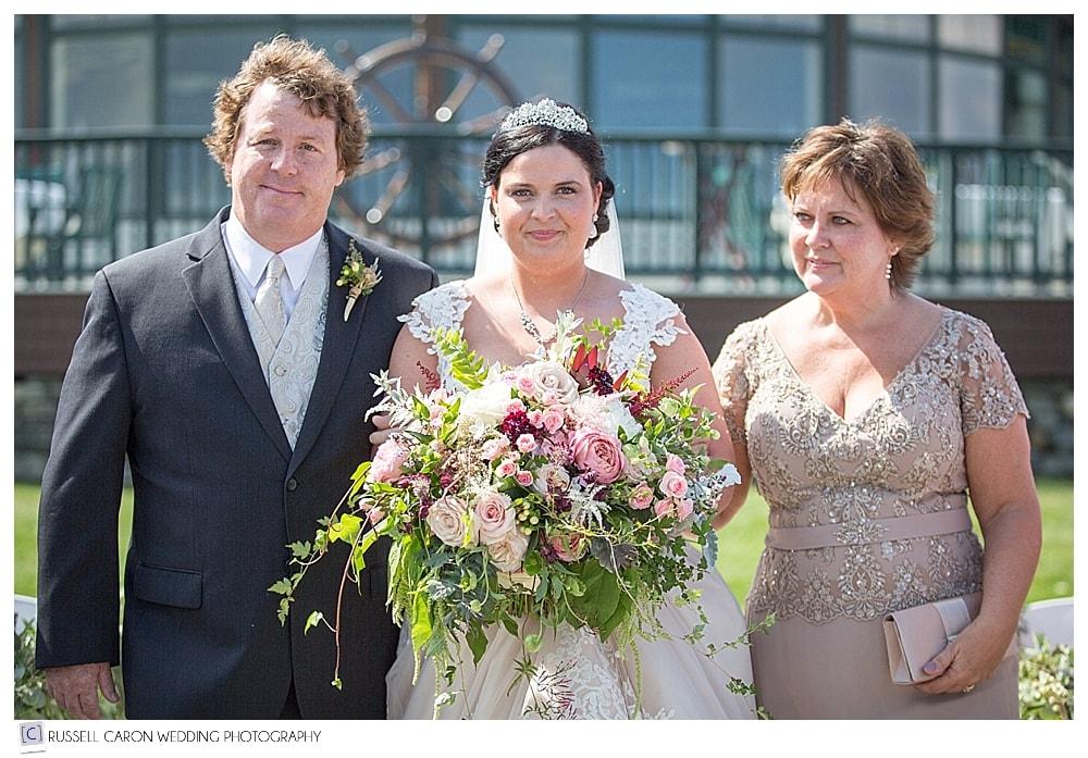 bride-walking-down-aisle-with-parents