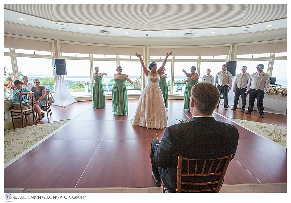 bride-and-bridesmaids-dance-for-groom
