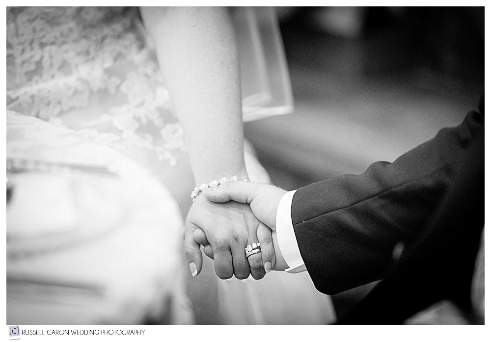 bride-and-groom-hold-hands