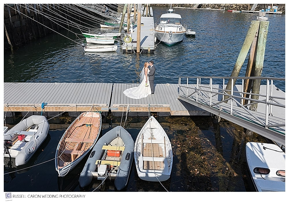 bride and groom on the dock at Rockport Harbor, Maine