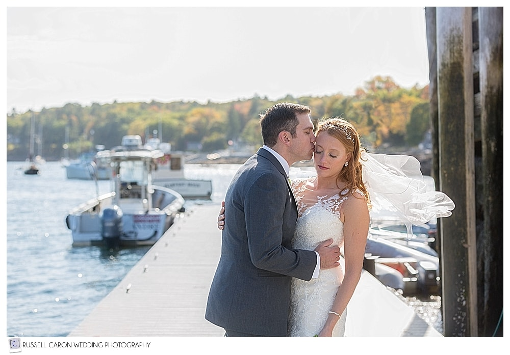 bride and groom on the dock in Rockport Harbor, Maine