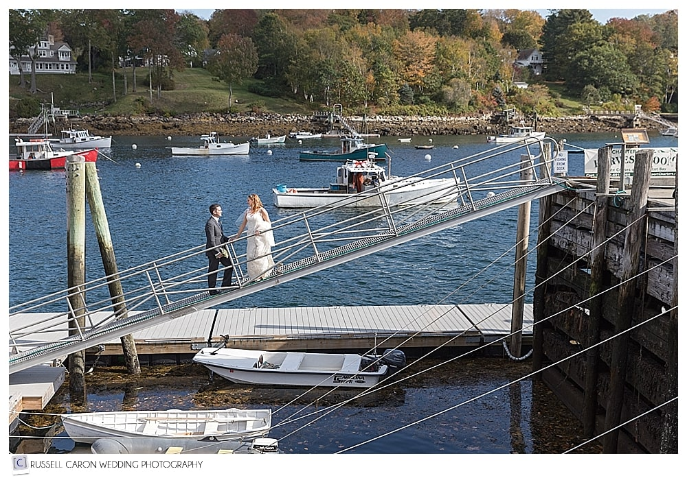 bride and groom walking from the dock at Rockport Harbor, Maine
