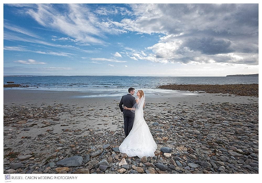 bride and groom on the rocky shore at Northport, Maine