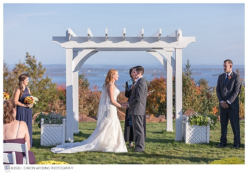 bride and groom in front of the arbor at Point Lookout Resort weddings