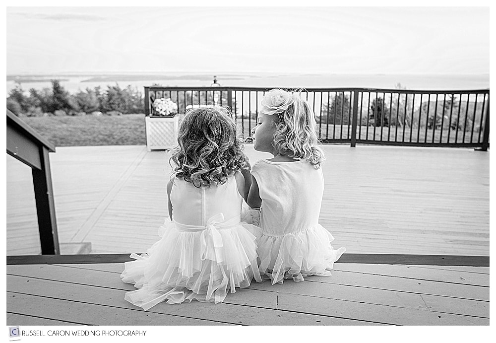 two little girls sitting side by side during Point Lookout Resort wedding reception