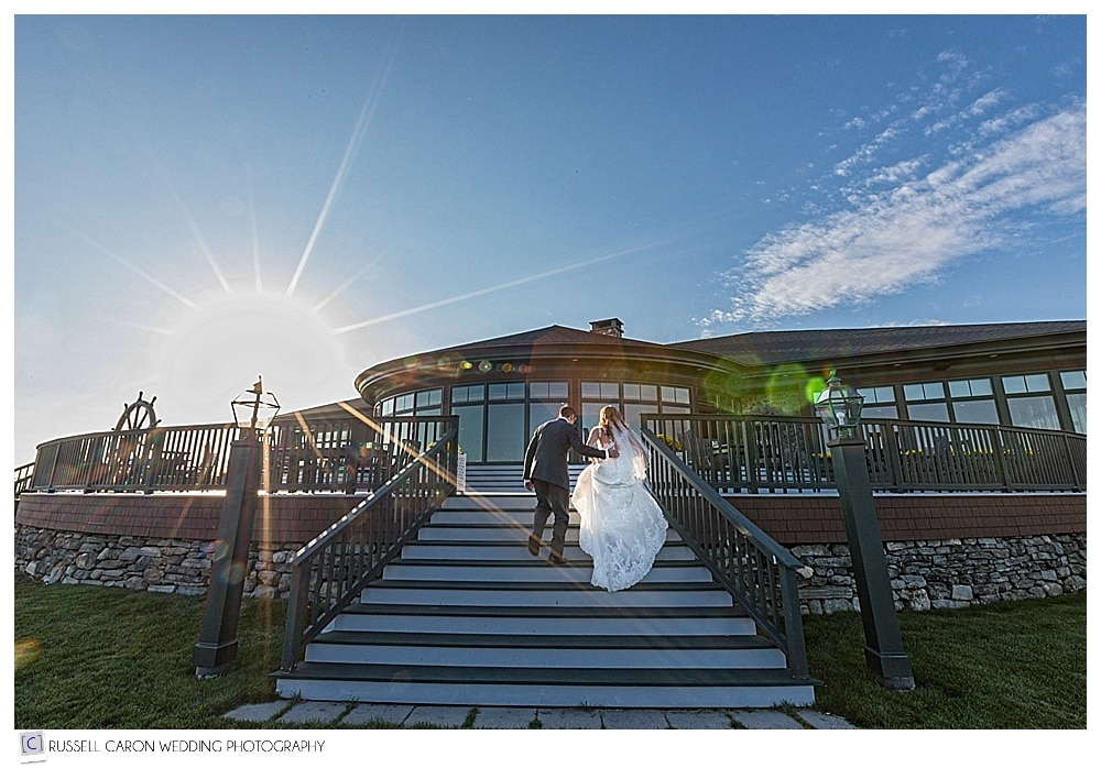 bride and groom walking up the steps at Point Lookout Resort Northport, Maine