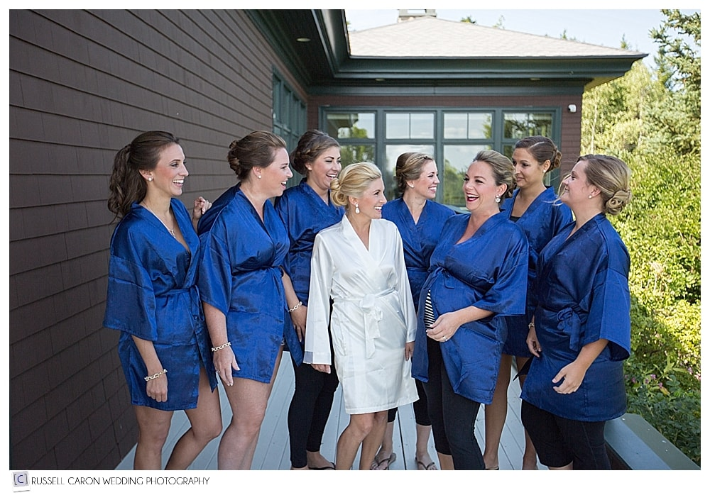bride and bridesmaids in robes, on the deck at Point Lookout