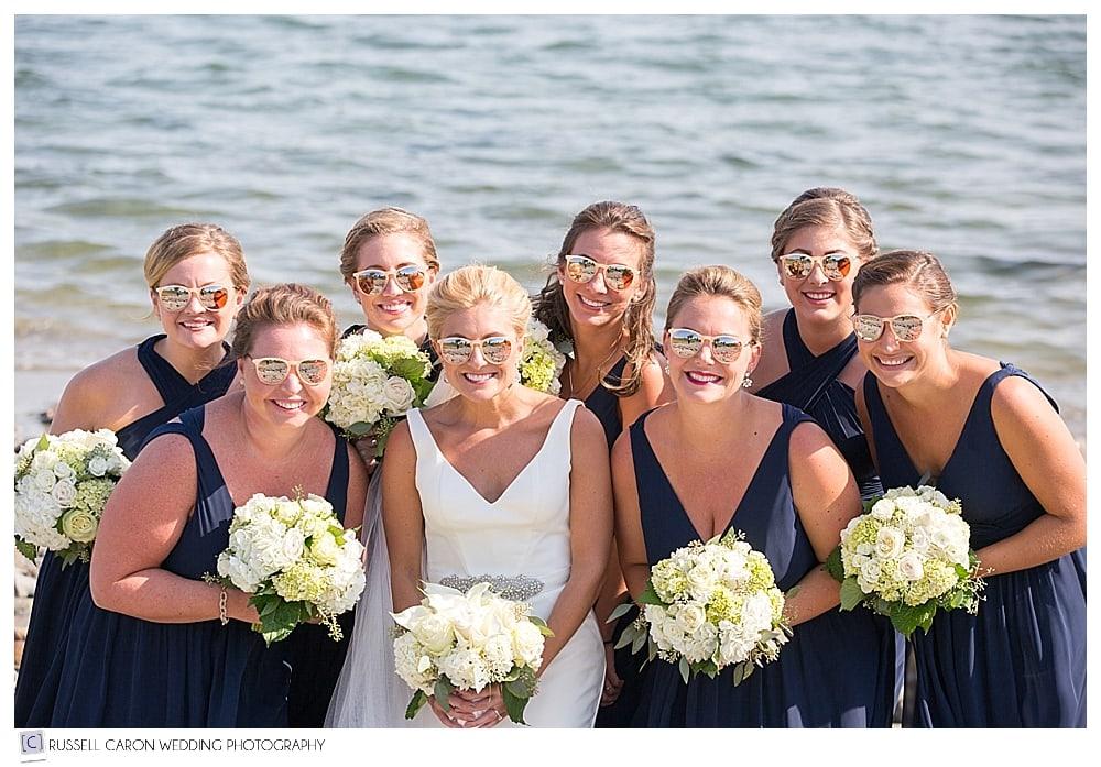 bride and bridesmaids wearing sunglasses