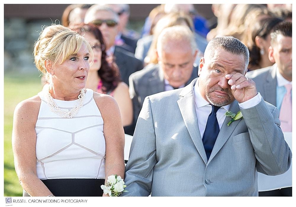 bride's parents during wedding ceremony