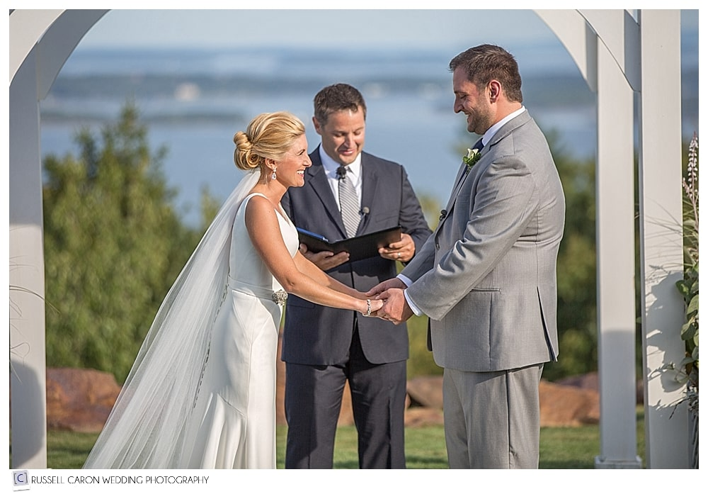 bride and groom standing before officiant at point lookout wedding ceremony