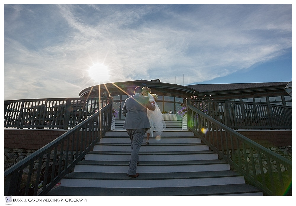 bride and groom walking up the stairs at point lookout wedding