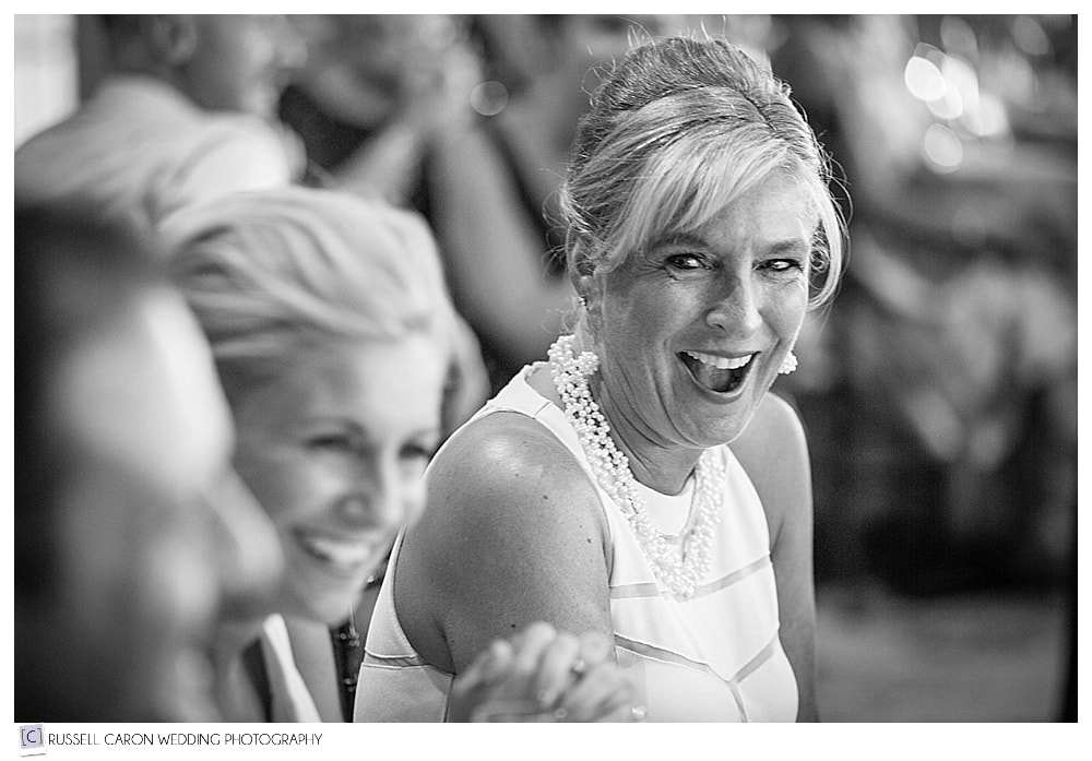 mother of bride laughing during reception