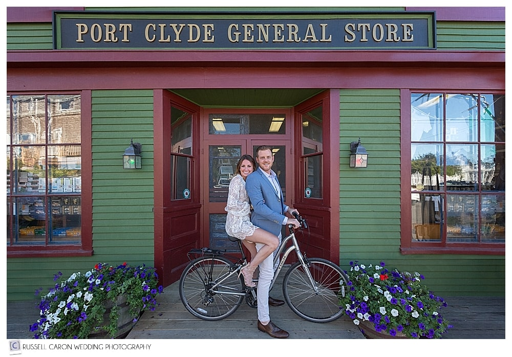 man and woman on bicycle in front of Port Clyde General Store