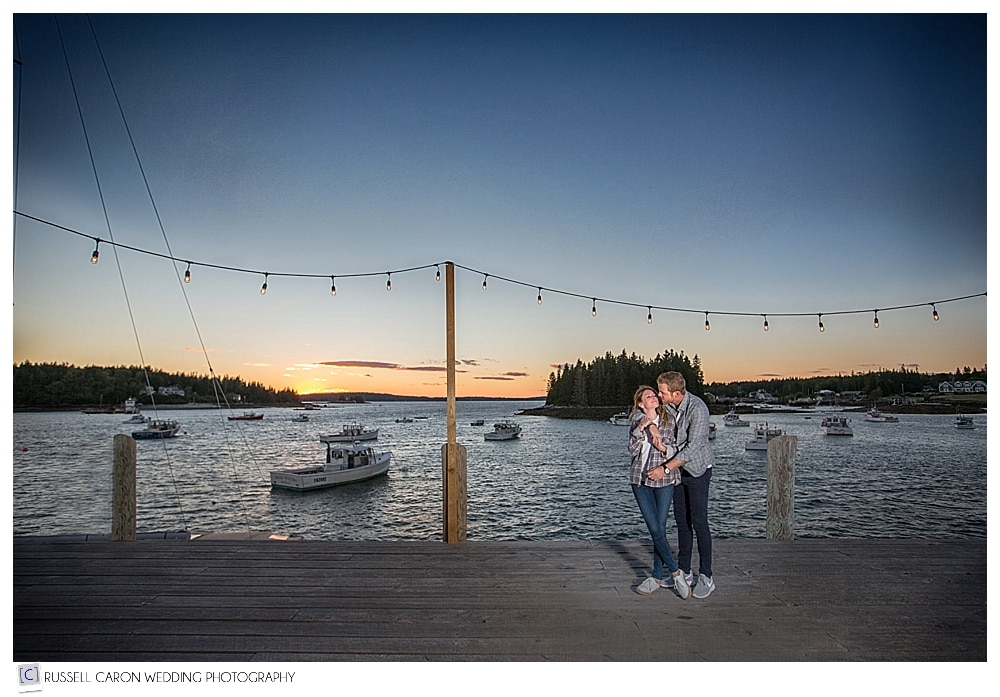man and woman holding each other on fishing dock in port clyde maine