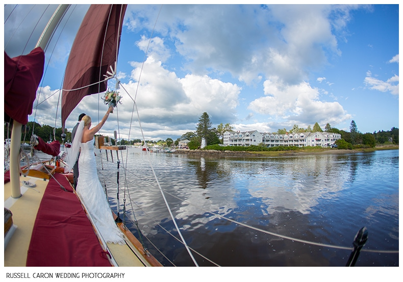 bride-and-groom-on-sailboat-approacing-nonantum-resort-kennebunkport