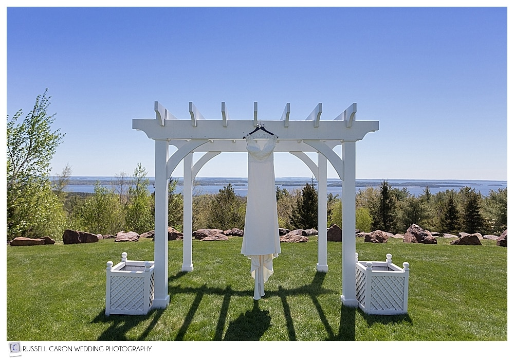 wedding gown hanging from arbor at Point Lookout Northport Maine wedding