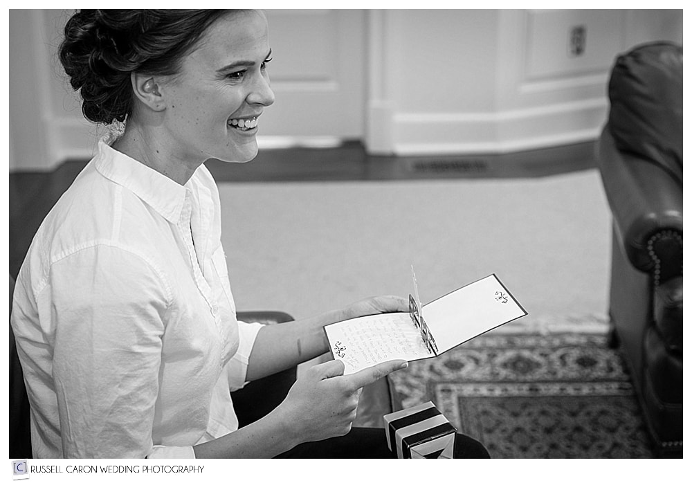 bride reading wedding day letter from groom