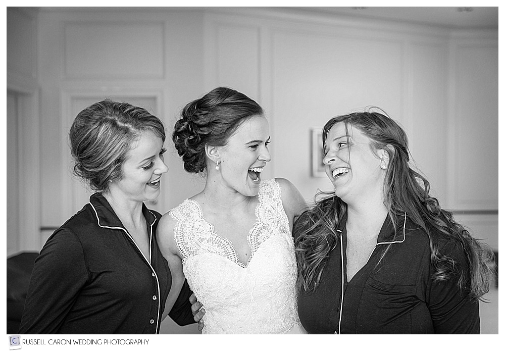 bride, maid of honor, and bridesmaid laughing