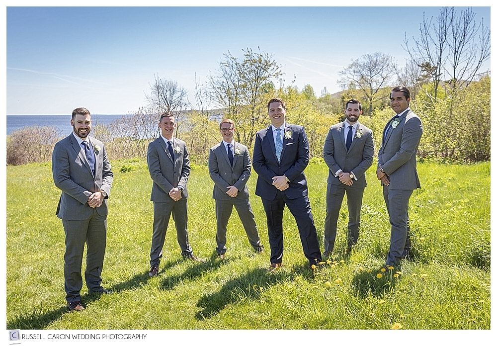 groom with groomsmen during Maine wedding