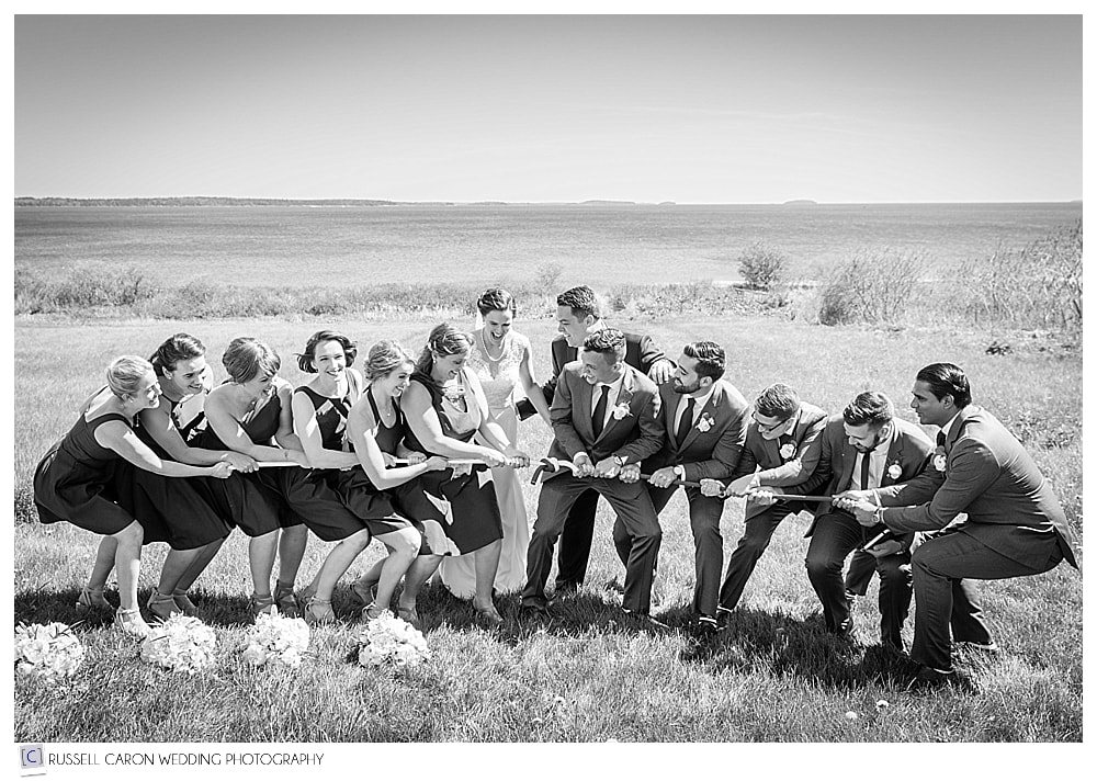bridal party having tug of war at seaside Maine wedding