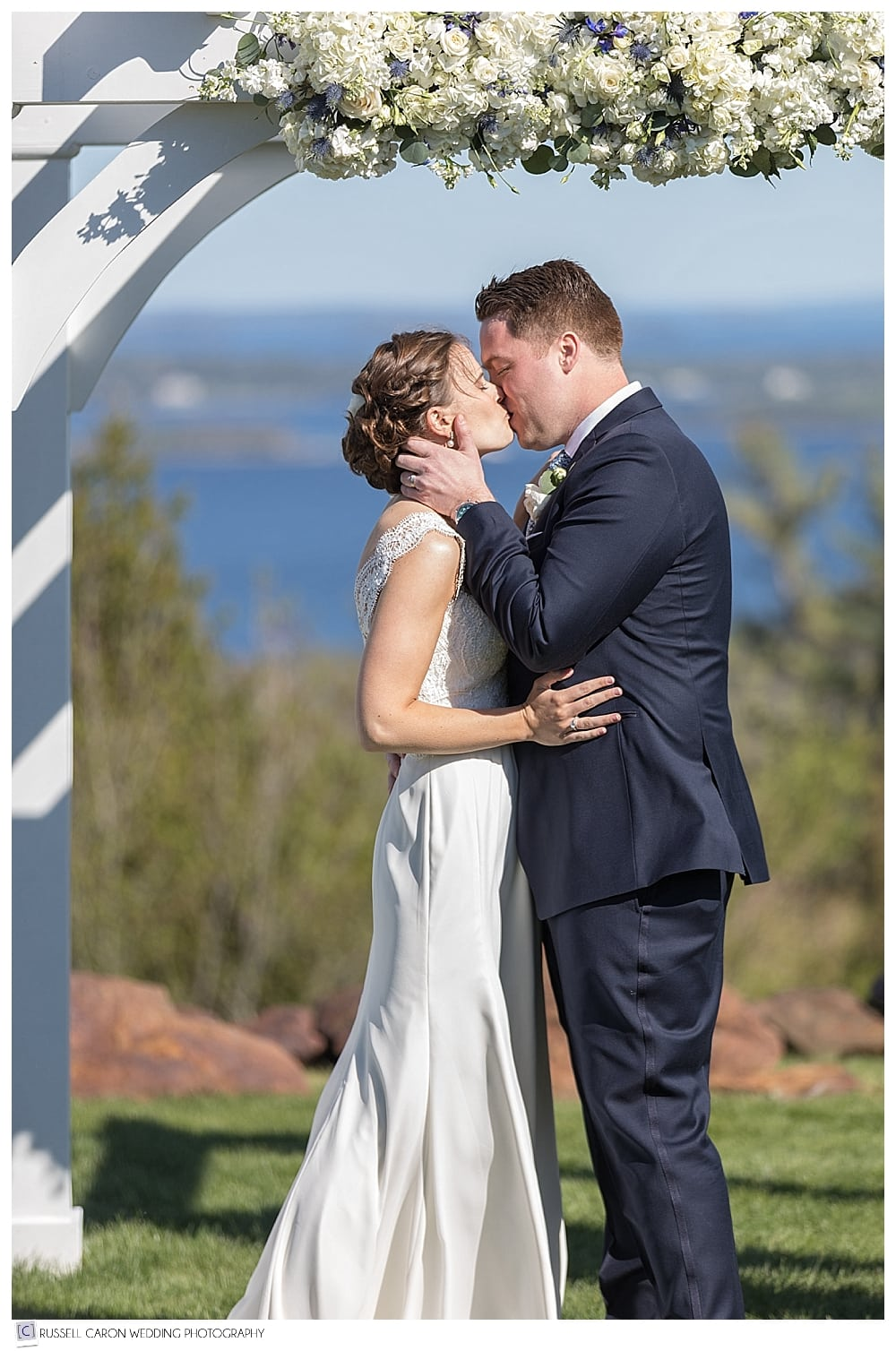 bride and groom during first kiss at Point Lookout Maine wedding