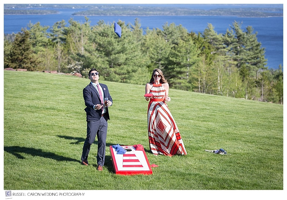 wedding guests playing lawn games at Point Lookout Northport Maine wedding reception
