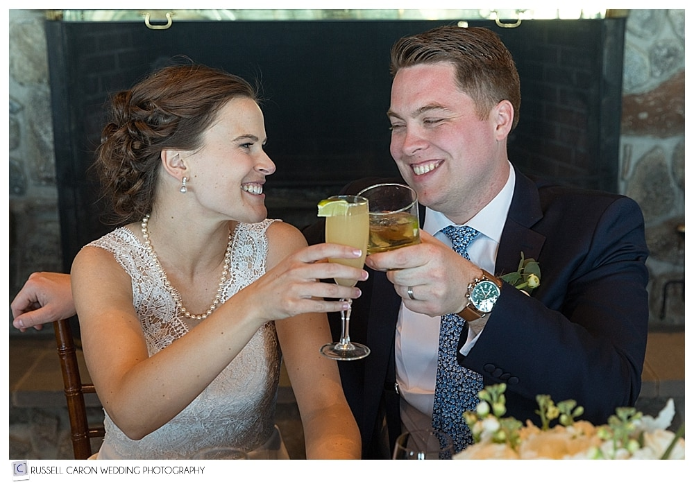 bride and groom toasting each other during wedding reception