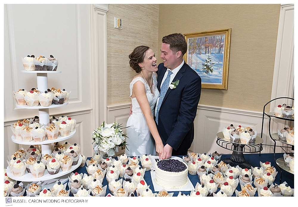 Bride and groom during wedding cake cutting