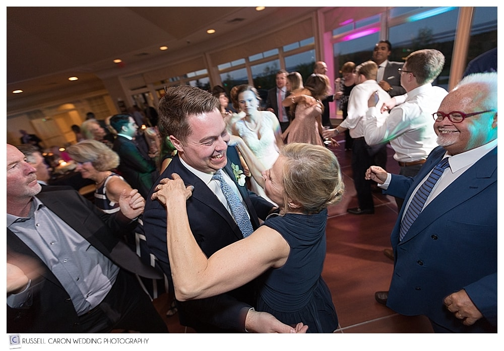 groom and mother dancing during wedding reception
