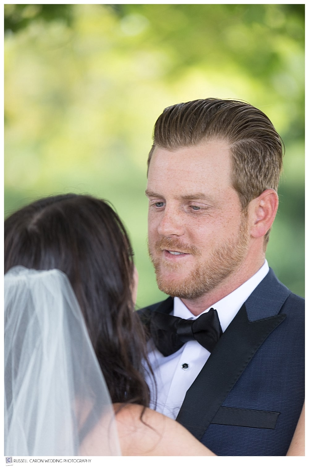 groom looking at bride during first look