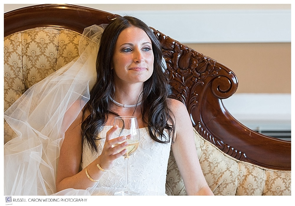 bride sitting with glass of wine