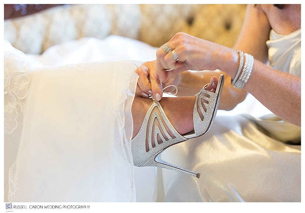 bride's shoes being tied