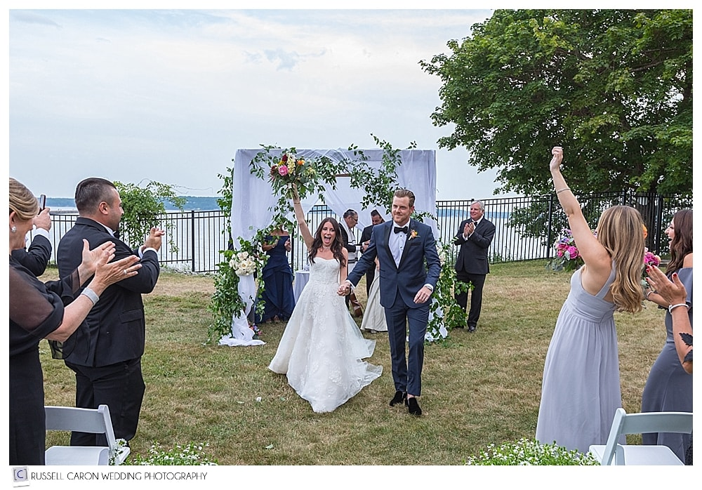 bride and groom during the recessional