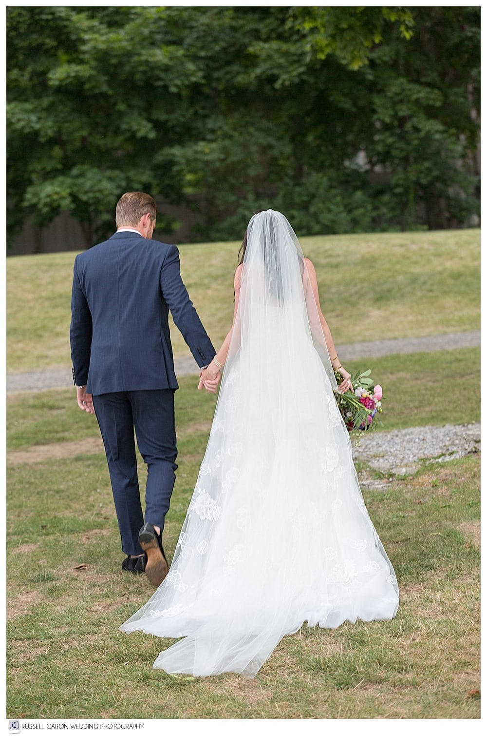 bride and groom walking hand in hand