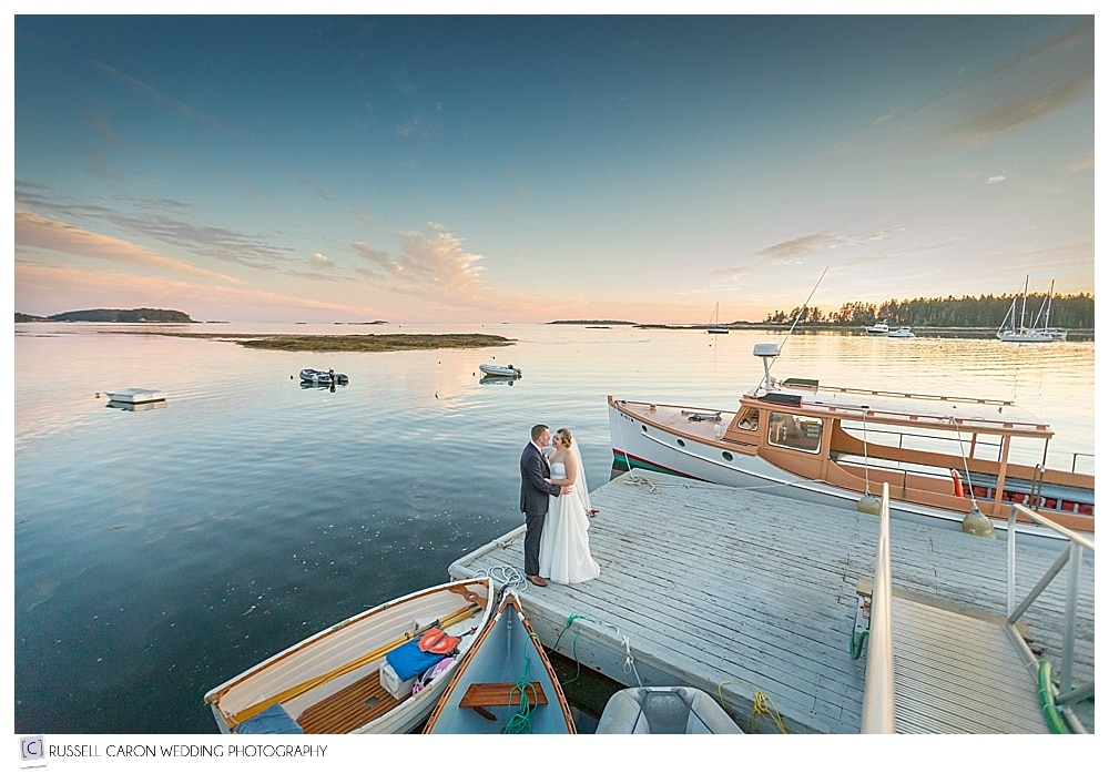 bride and groom standing on the dock at their Sebasco Harbor wedding