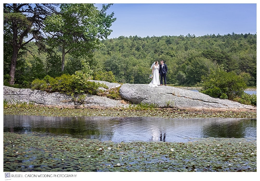 bride and groom on the rock at Sebasco Harbor Resort, Phippsburg, Maine