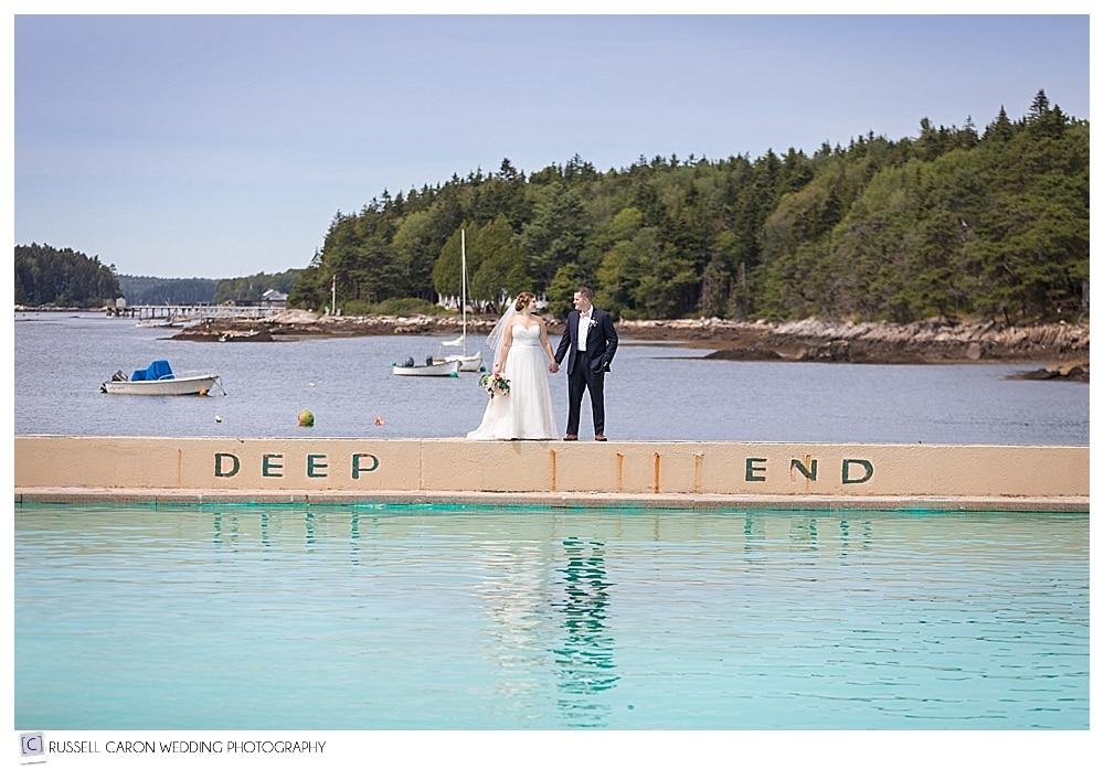 Bride and groom at the deep end of the Sebasco Harbor Resort salt water pool
