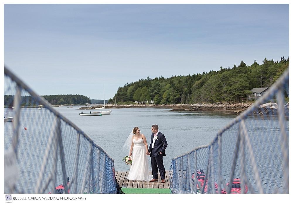 Bride and groom on the dock at Sebasco Harbor Resort