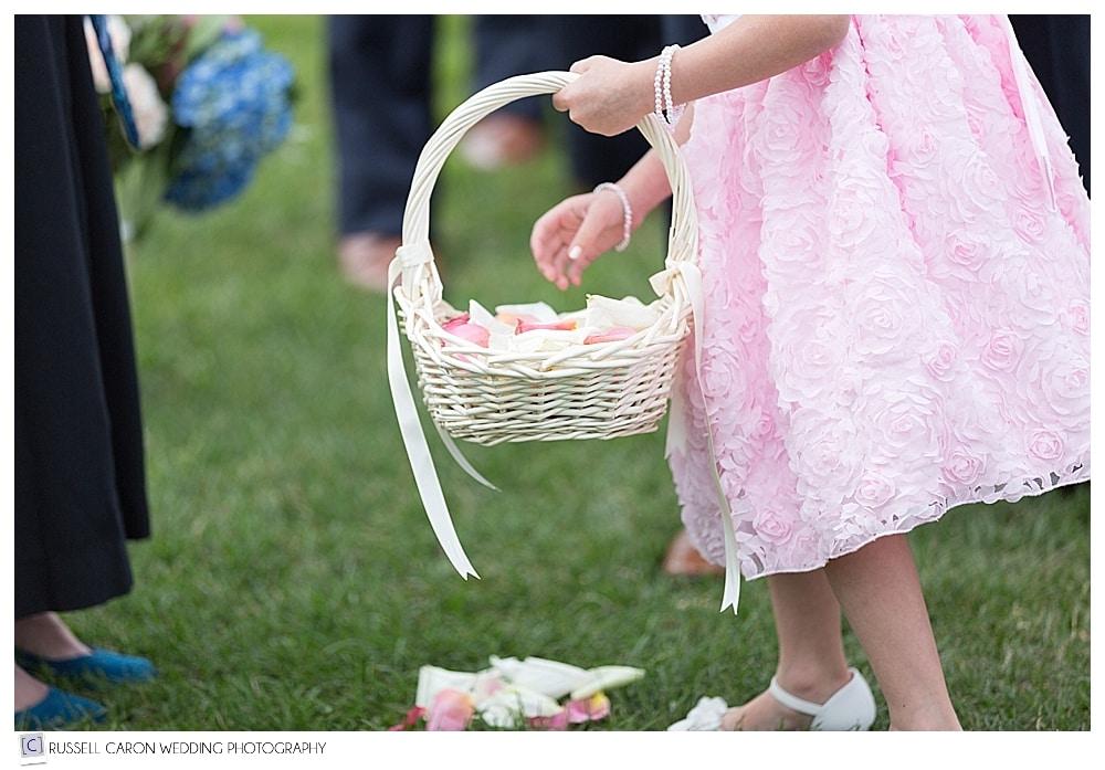 flower girl and basket of petals