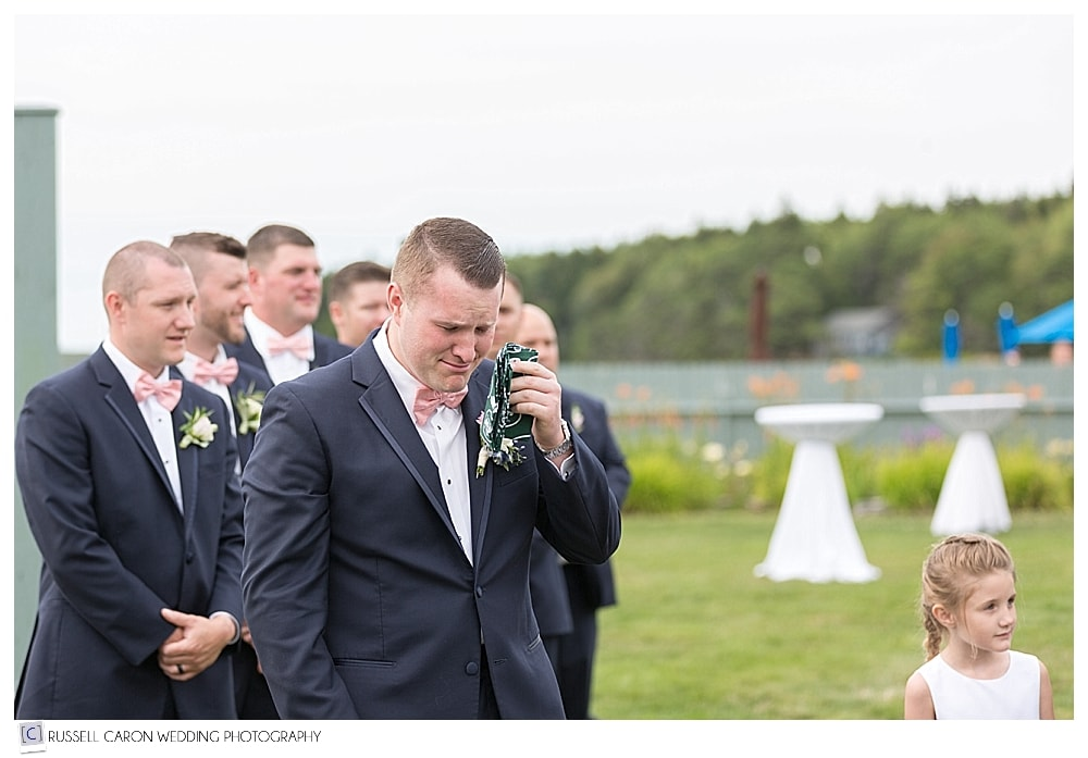 groom cries as bride walks down the aisle