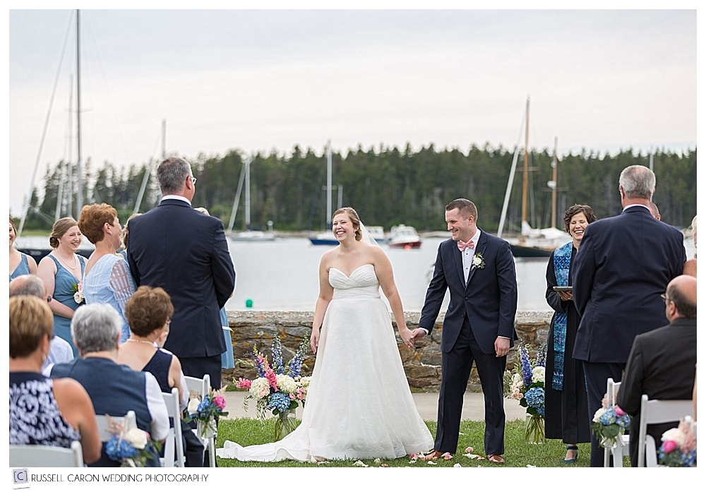 bride and groom standing side by side during wedding ceremony