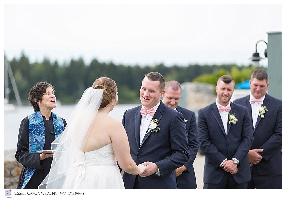 Groom smiling during wedding ceremony