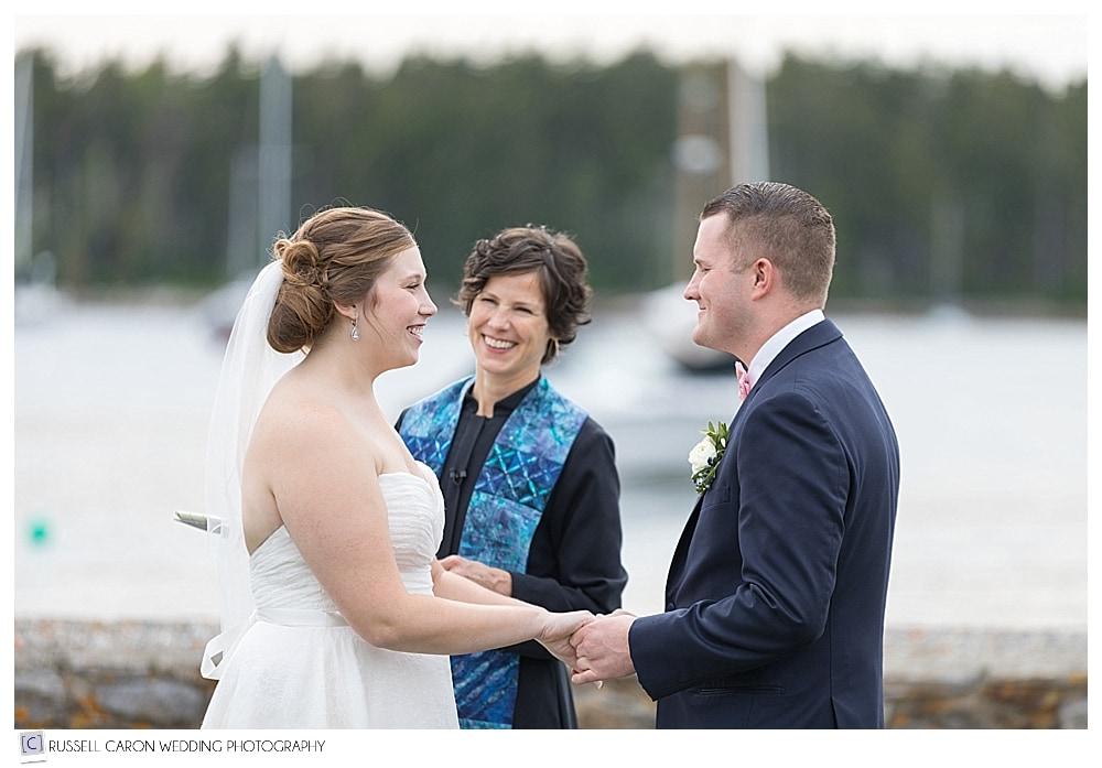 bride, groom, and Rev Erika Hewitt during wedding ceremony