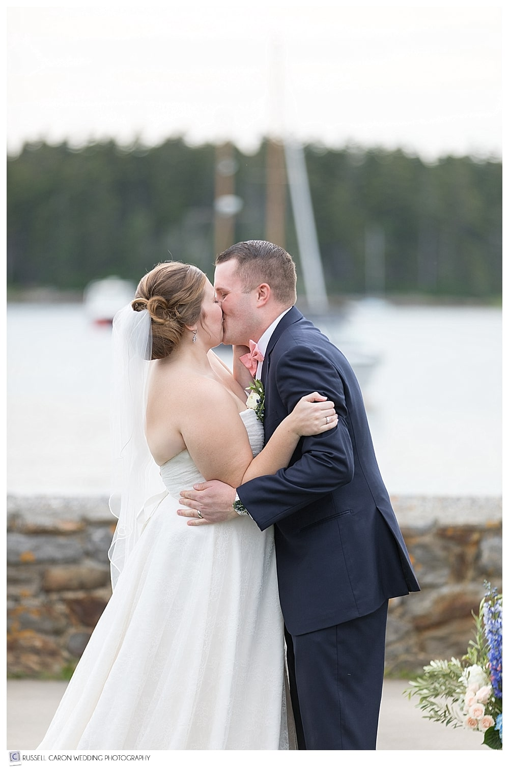 bride and groom during first kiss