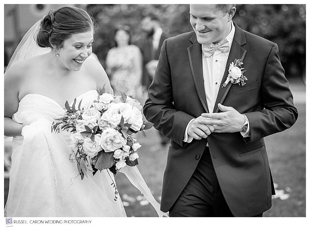 groom feeling wedding band on his finger